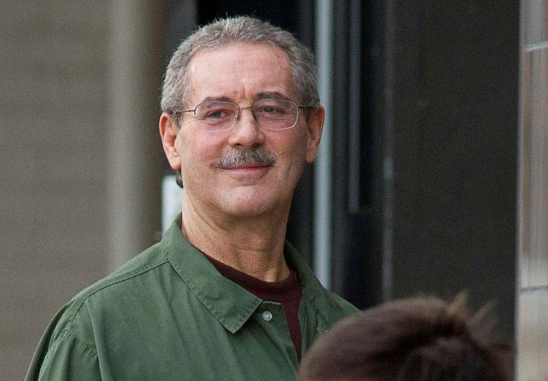 © Reuters. FILE PHOTO: Allen Stanford smiles as he waits to enter the Federal Courthouse where the jury is deliberating in his criminal trial in Houston