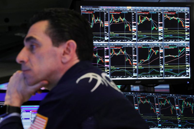 © Reuters. FILE PHOTO: A trader at the New York Stock Exchange works as markets continue to react to the coronavirus disease (COVID-19) inside of the NYSE in New York