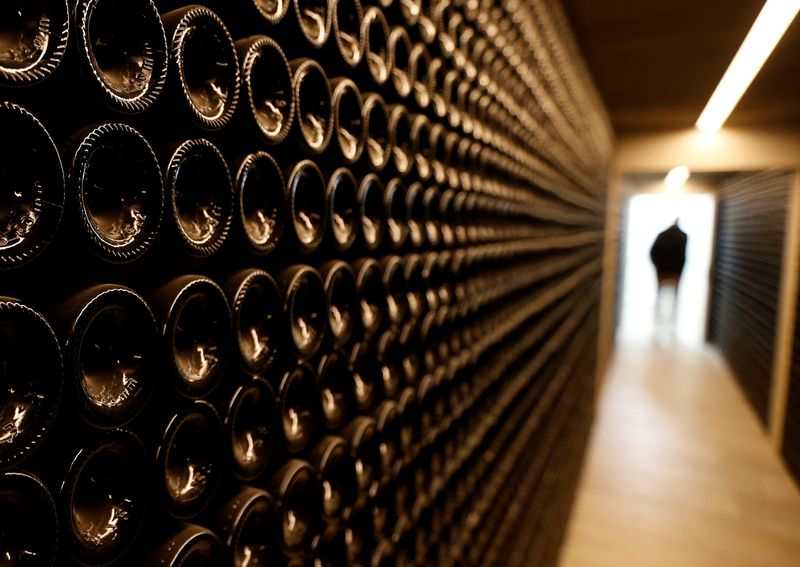 © Reuters. FILE PHOTO: Bottles of red wine are seen in the cellar of Chateau Le Puy in Saint Cibard