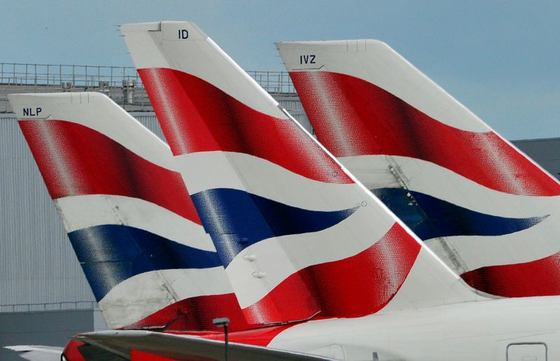 © Reuters. FILE PHOTO: File photo of British Airways logos on tailfins at  Heathrow Airport in London