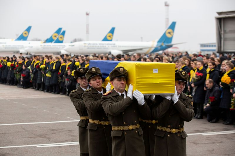 © Reuters. FILE PHOTO: Memorial ceremony for the Ukrainian victims of Iran plane crash at the Boryspil International Airport, outside Kiev