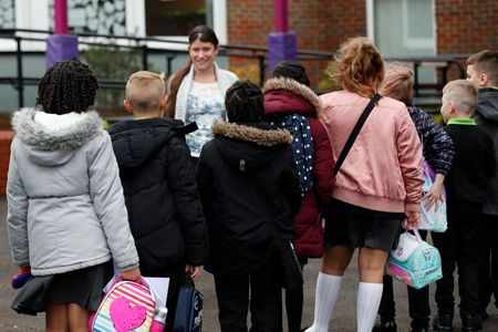 UK government under pressure to close primary schools as unions revolt By Reuters