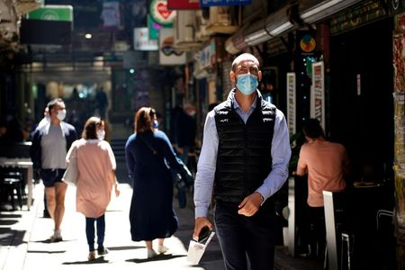Australia's virus cluster expands further as masks made compulsory By Reuters