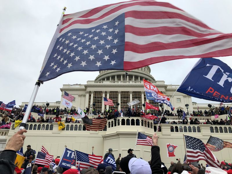 Under heavy guard, Congress back to work after Trump supporters storm U.S. Capitol