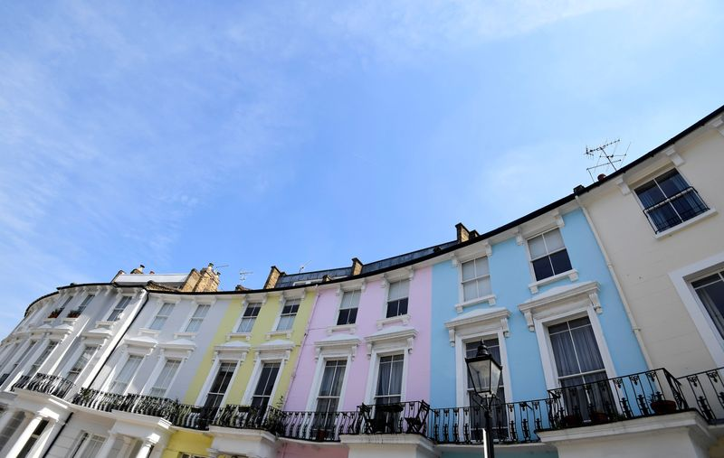 © Reuters. Houses are seen painted in various colours in a residential street in London