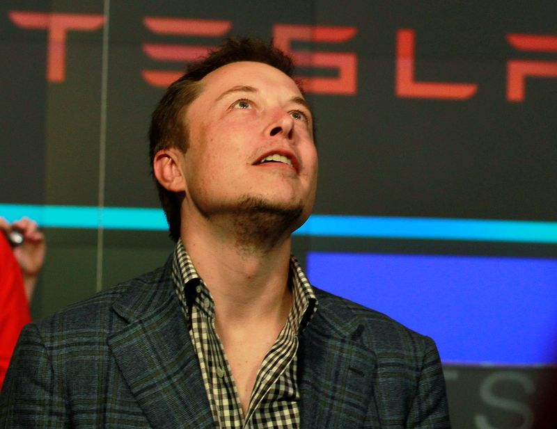 © Reuters. FILE PHOTO: CEO of Tesla Motors Elon Musk reacts following the company's initial public offering at the NASDAQ market in New York