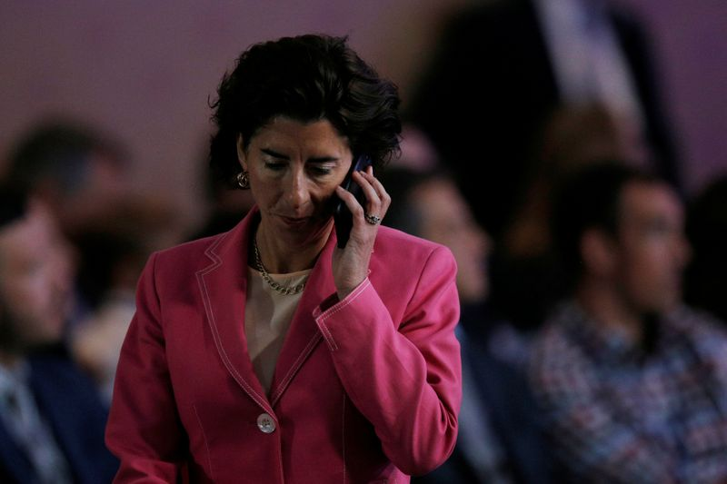 © Reuters. FILE PHOTO:  Rhode Island Governor Gina Raimondo answers a phone call during the National Governors Association Summer Meeting in Providence