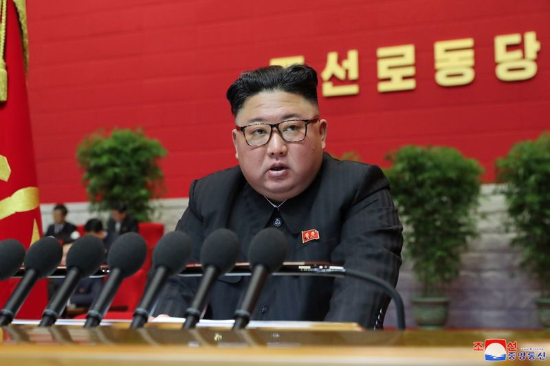 © Reuters. FILE PHOTO: North Korean leader Kim Jong Un speaks during the 8th Congress of the Workers' Party in Pyongyang