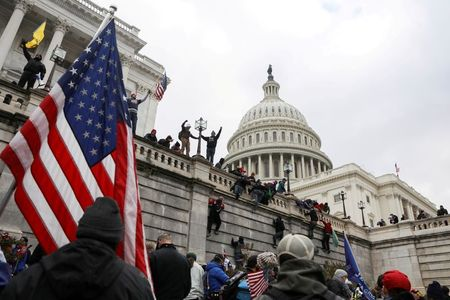 Off-duty police, firefighters under investigation in connection with U.S. Capitol riot By Reuters
