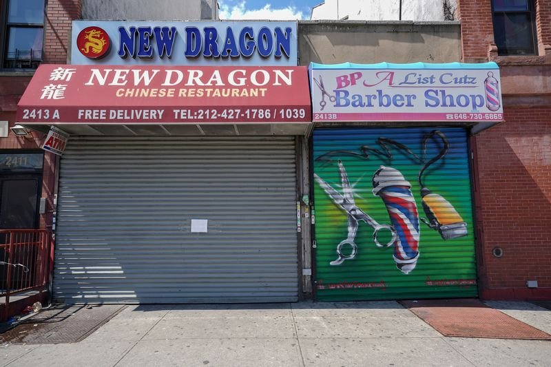 © Reuters. FILE PHOTO: A Chinese restaurant and barber shop in Harlem are closed,