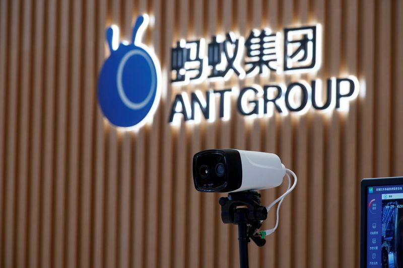 © Reuters. FILE PHOTO: A thermal imaging camera is seen in front of a logo of Ant Group at the headquarters of Ant Group, an affiliate of Alibaba, in Hangzhou