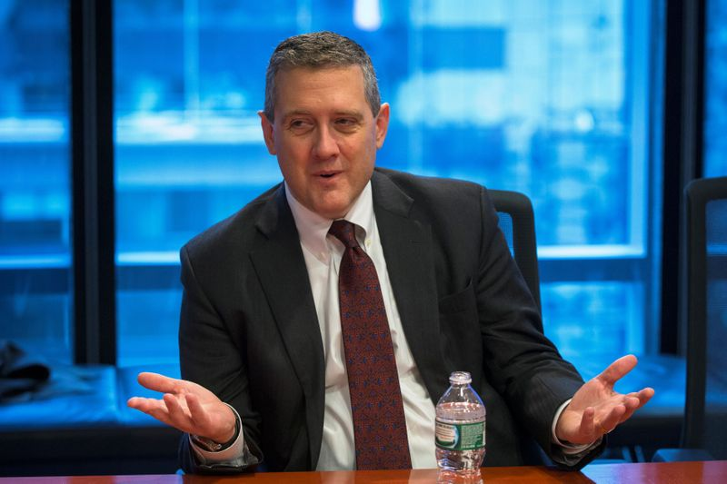 © Reuters. FILE PHOTO: St. Louis Fed President James Bullard speaks about the U.S. economy during an interview in New York