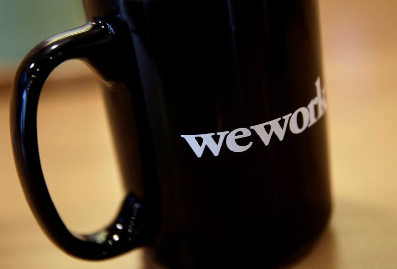 © Reuters. FILE PHOTO: The WeWork logo is seen on a cup at a WeWork office in Beijing