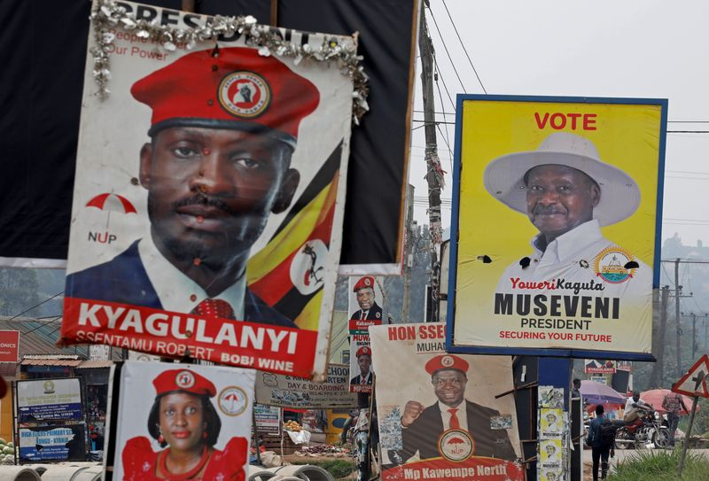 © Reuters. FILE PHOTO: Elections billboards for Uganda's President Yoweri Museveni, and opposition leader and presidential candidate Robert Kyagulanyi, also known as Bobi Wine, are seen on a street in Kampala