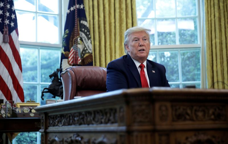 © Reuters. FILE PHOTO: U.S. President Trump answers questions during an interview with Reuters in the Oval Office of the White House in Washington