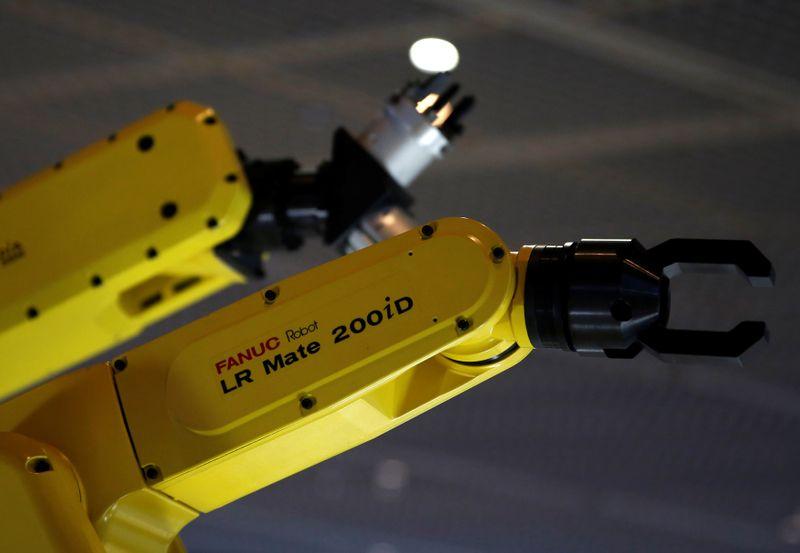 © Reuters. FILE PHOTO: Fanuc Corp's machinery models are seen at Narita International airport terminal 1