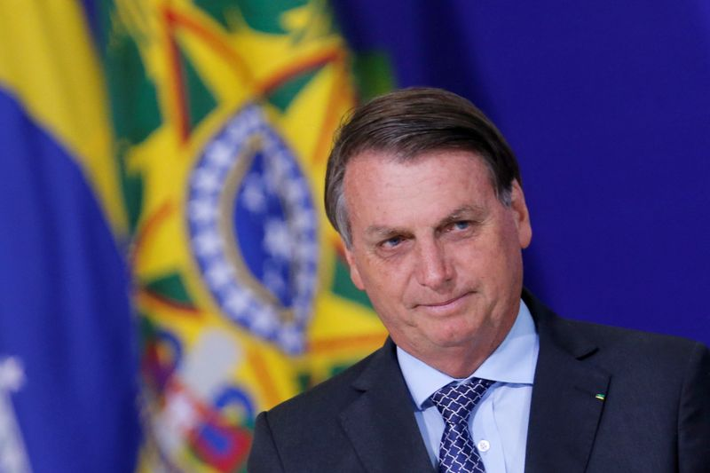 © Reuters. Brazil's President Jair Bolsonaro looks on during a ceremony at the Planalto Palace