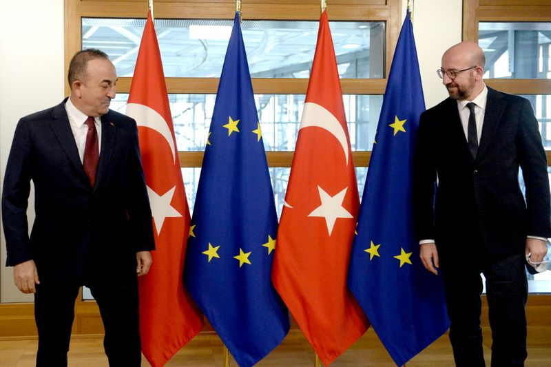 © Reuters. Turkish Foreign Minister Mevlut Cavusoglu and European Council President Charles Michel meet in Brussels