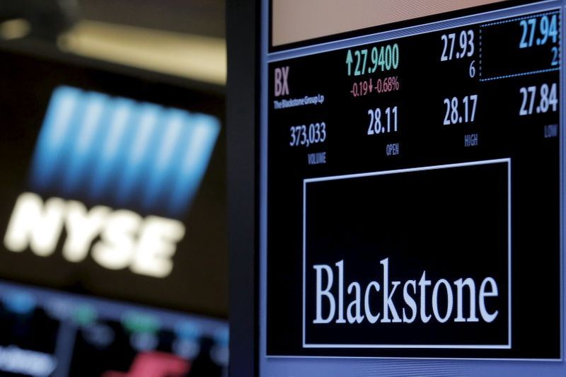 © Reuters. The ticker and trading information for Blackstone Group is displayed at the post where it is traded on the floor of the New York Stock Exchange
