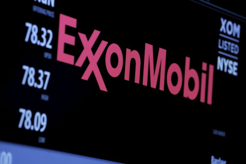 © Reuters. FILE PHOTO: The logo of Exxon Mobil Corporation is shown on a monitor above the floor of the New York Stock Exchange in New York