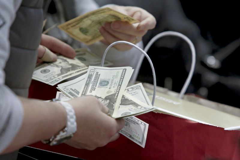 U.S. consumer spending decreases further; inflation creeping up