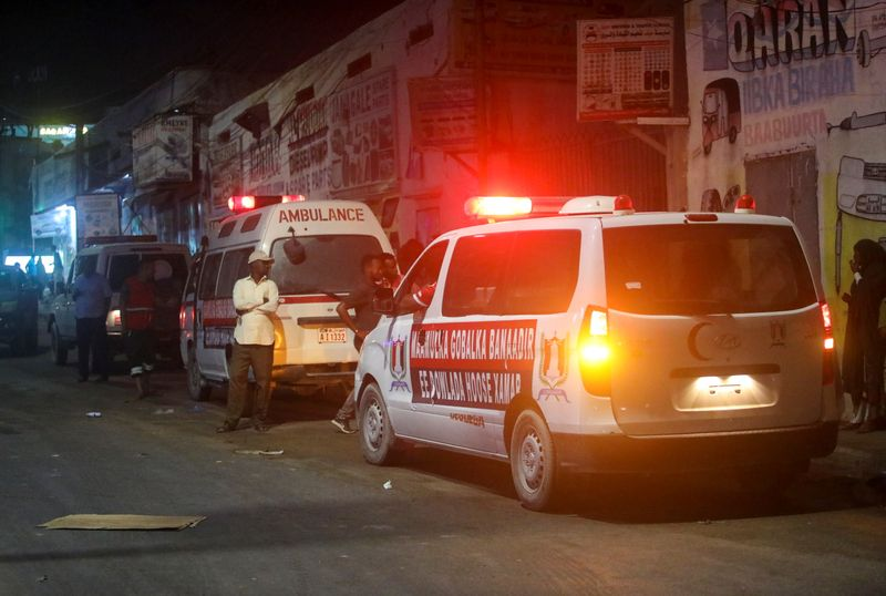 © Reuters. Ambulances are seen near the scene of a car bomb explosion in the Kilometre 4 area of Mogadishu