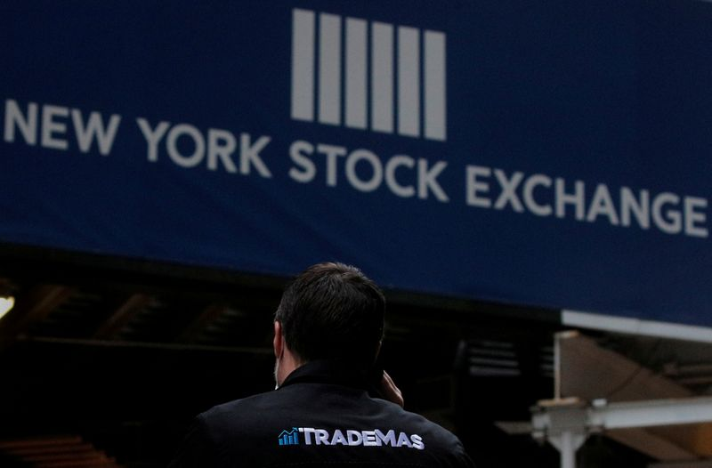 © Reuters. FILE PHOTO: Trader Frank Masiello talks on his phone on Wall St. outside the NYSE in New York
