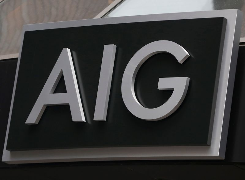 © Reuters. FILE PHOTO: A sign is displayed over the entrance to the AIG headquarters offices in New York's financial district