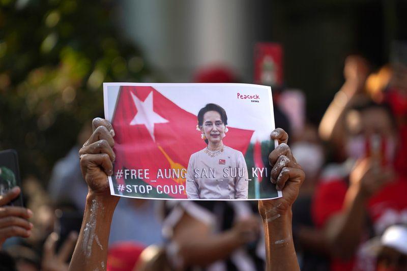 Suu Kyi's party demands her release as Myanmar generals tighten grip