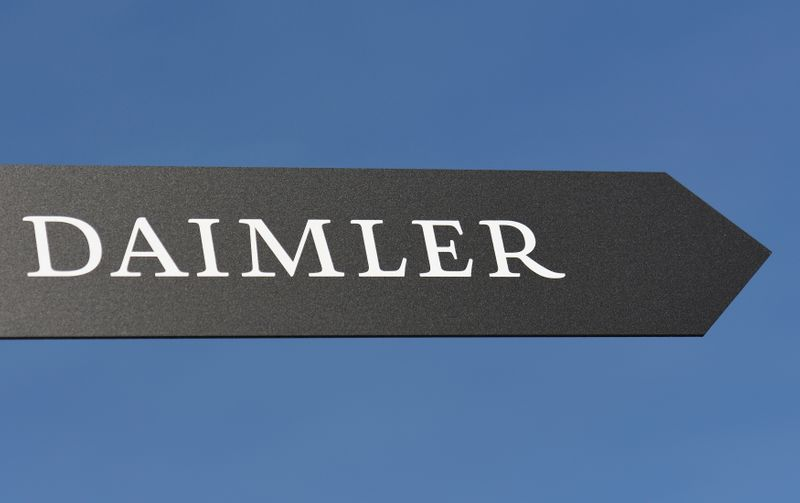 Daimler AG sign is pictured at the IAA truck show in Hanover