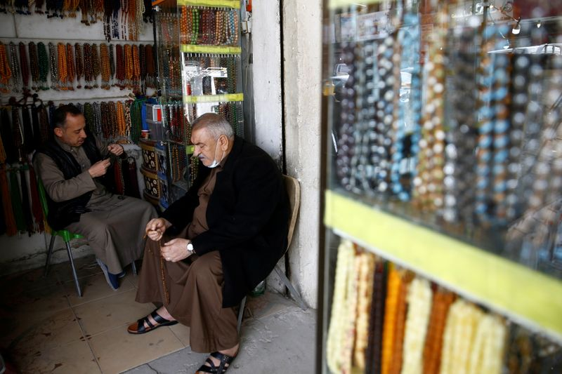 © Reuters. An Iraqi man sells rosaries at a shop in Falluja