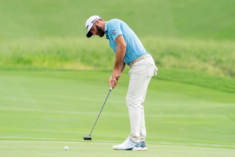Golf: Johnson holds on to clinch second Saudi International title