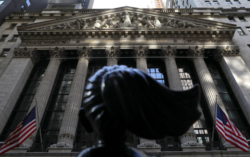 Wall Street sets record closing highs on stimulus hopes, vaccine deployment