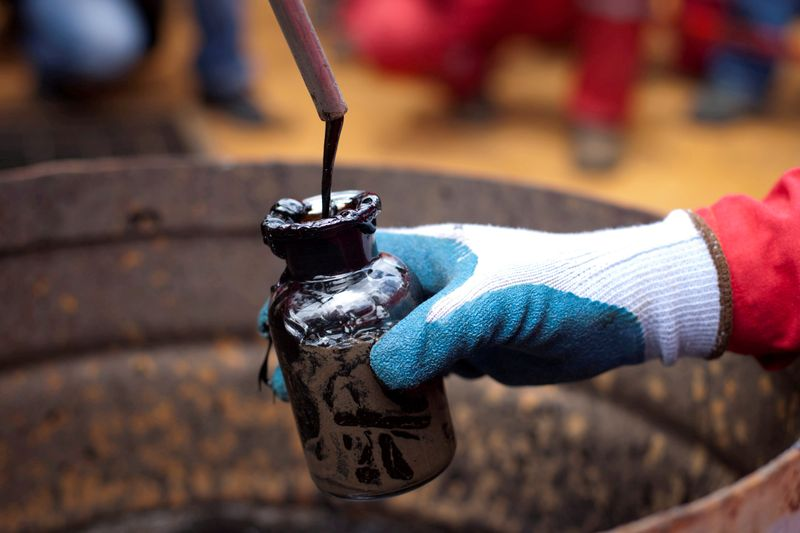 Oil climbs to 13-month highs on output cuts, demand recovery hopes
