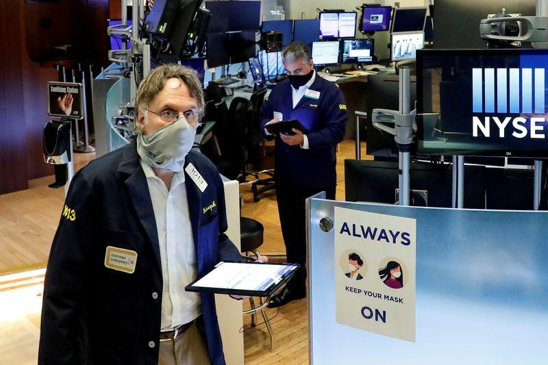 Stocks edge lower on Biden warning about China