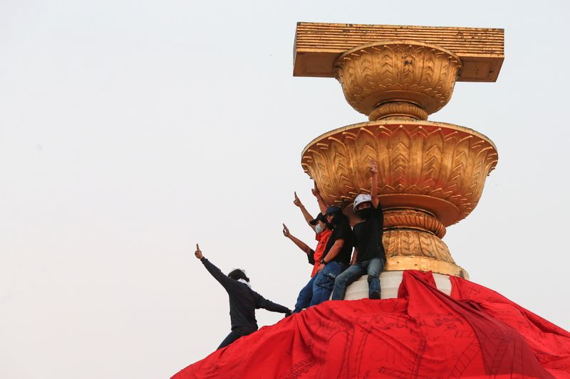 Thai activists cover monument to protest royal defamation law