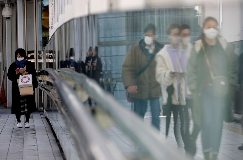 Japan's economy grows 12.7% in fourth quarter, beats forecast