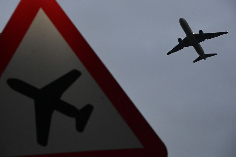 UK PM says foreign travel curbs to stay until at least mid-May