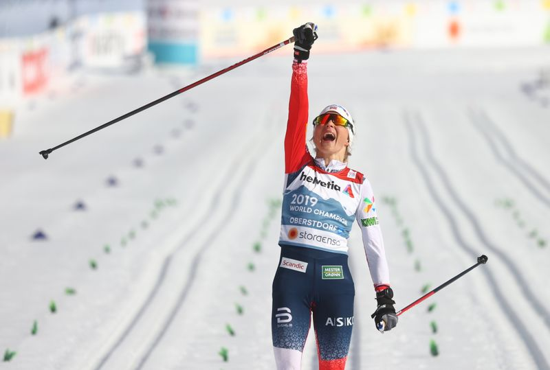 Nordic skiing: Blistering Johaug signs off with 30km gold