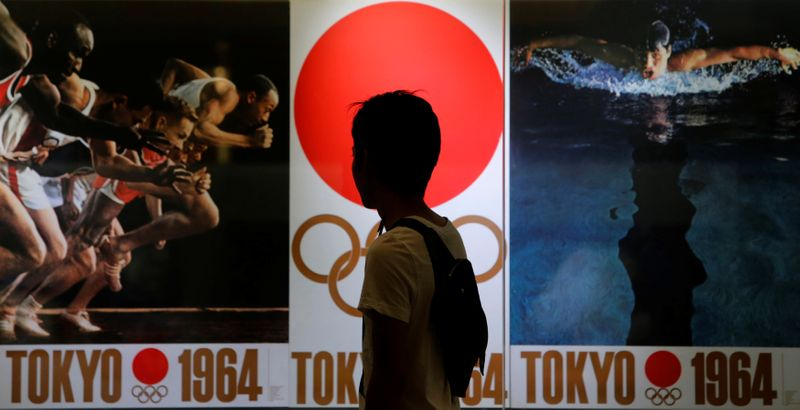 Tokyo Olympics chief invokes power of sport on anniversary of disaster