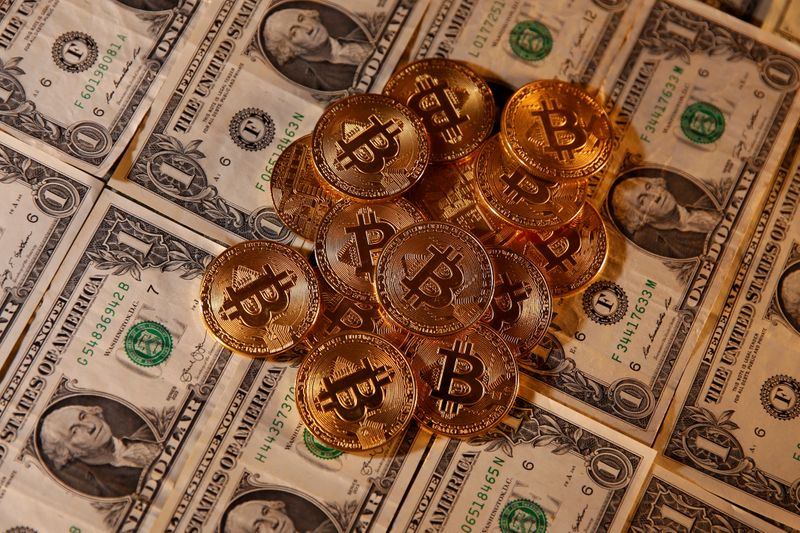 Bitcoin hits ,000 in record high By Reuters