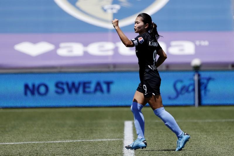 Japan soccer player Kawasumi confirms won't take part in torch relay
