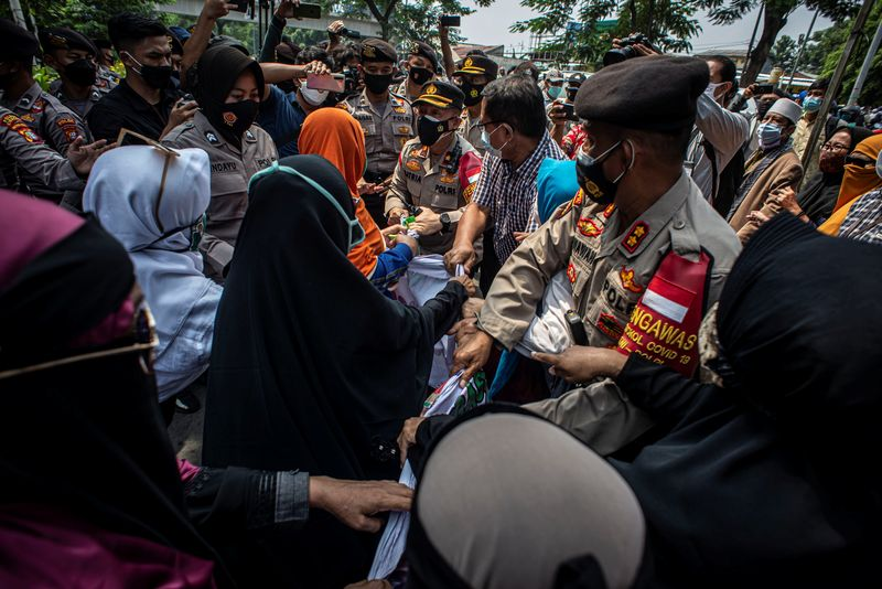 Influential Indonesian cleric accused of incitement over celebrated homecoming