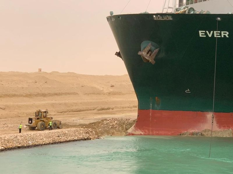 Ship stuck in Suez like a 'beached whale', firm aiming to free it says