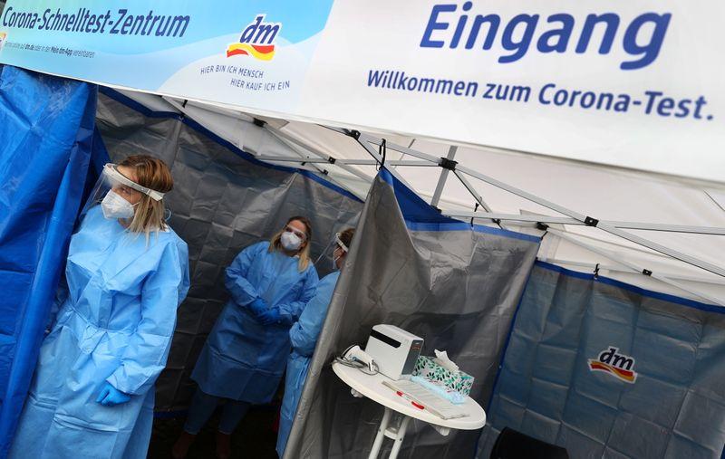 Germany must suppress virus now or risk losing control, Merkel aide says