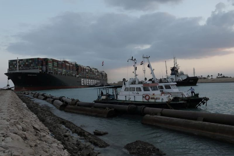 Hopes of reopening Suez Canal boosted by partial refloating of jammed ship