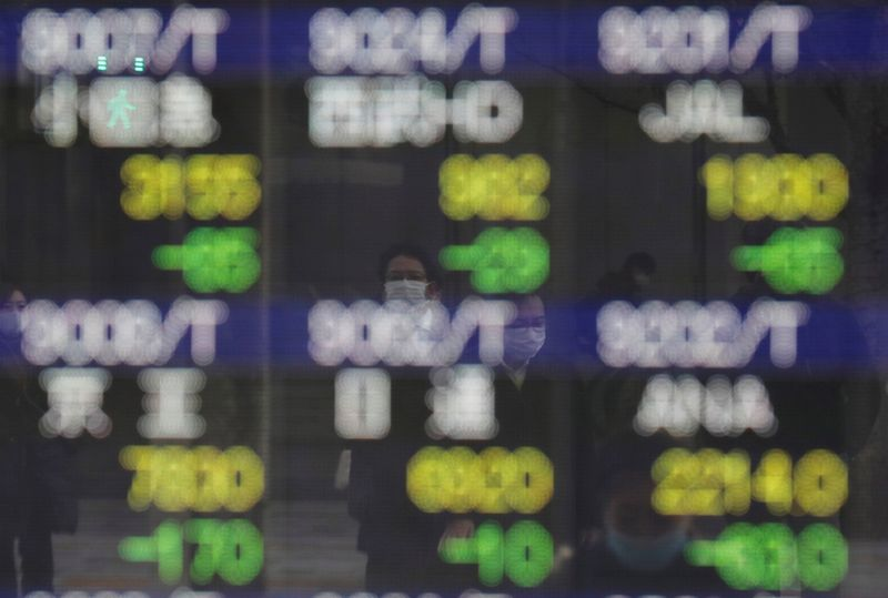 Asian shares defensive, set for monthly loss on bond rout