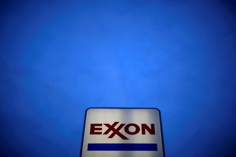 Exxon Mobil signals first profit in five quarters on price gains