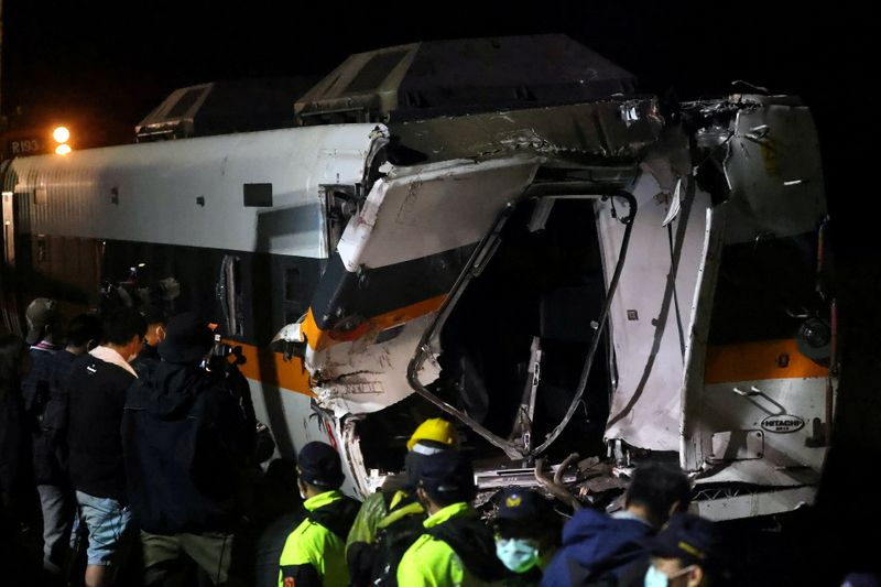 Taiwan rescuers work to bring out last body from wrecked train