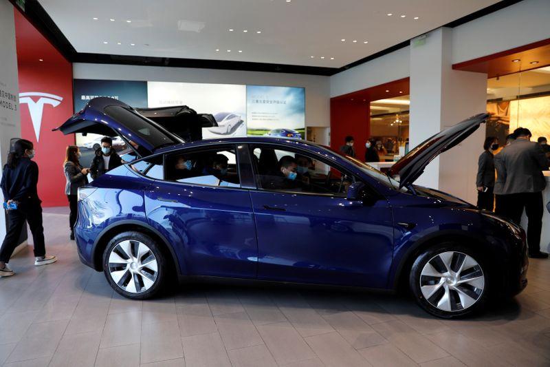 Tesla shares surge after electric carmaker posts record deliveries